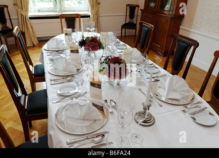 Banquet table set for six people in the Biedermeierzimmer or Biedermeier Room of the Krickenbeck moated castle, - Stock Photo