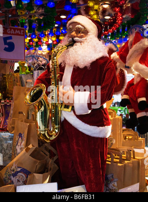 A Santa Claus Mannequin Playing a Saxophone on an Fairground Amusement Stall. - Stock Photo