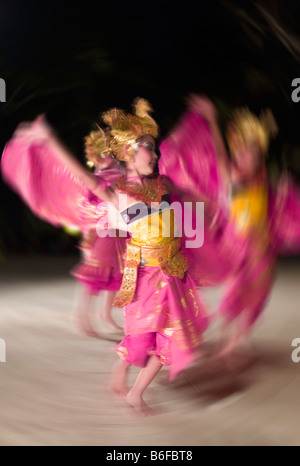 Balinese children present the traditional Legong dance to tourists in Kuta, Bali, Indonesia, Asia - Stock Photo