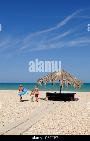 Mother with children on the beach of Pineto, Abruzzi, Italy, Europe - Stock Photo
