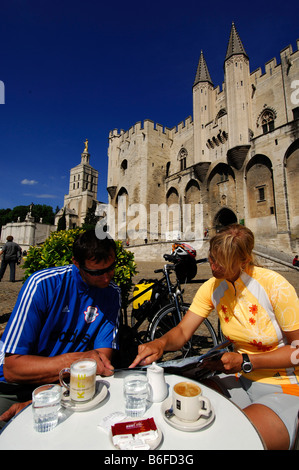 Cyclists taking a break in front of the Popes' Palace in Avignon, Provence, France, Europe - Stock Photo