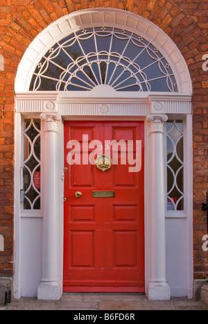 Red front door in the famous Georgian Merrion Square, Dublin, Republic of Ireland - Stock Photo
