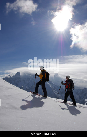 Snowshoe hikers on the Plaetzwiese Meadow in front of the Monte Cristallo Massif, High Puster Valley or Alto Pusteria, - Stock Photo