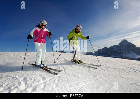 Skiers skiing down Monte Elmo or Helm Mountain, Sexten, Hochpustertal Valley or High Puster Valley or Alto Pusteria, - Stock Photo