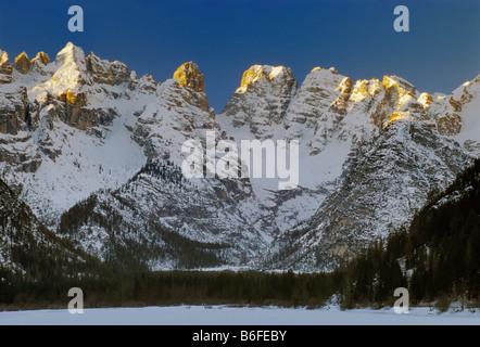 Cristallo Group over frozen Lago di Landro Dürrensee in winter Dolomites Südtirol Alto Adige region Italy - Stock Photo