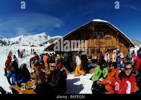 Skiers in front of a mountain hut, Arvengaden Restaurant, Kleine Scheidegg Mountain, Grindelwald, Bernese Alps, - Stock Photo