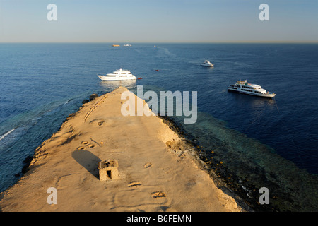 View from lighthouse over barren island onto the ocean to dive boats and reef, top dive location, Big Brother of - Stock Photo