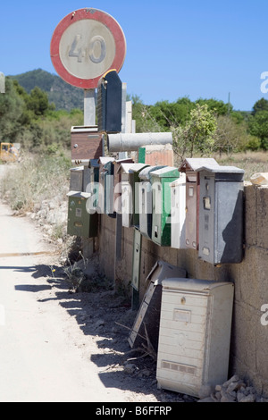 Letterboxes on a wall with a roadsign near Son Macia, Majorca, Balearic Islands, Spain, Europe - Stock Photo