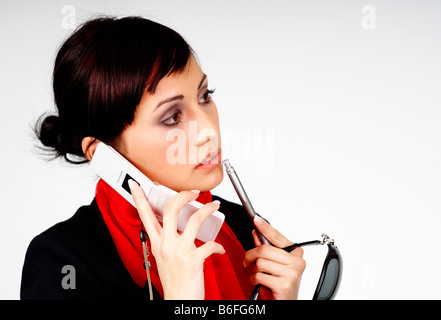 Young business woman talking on her cell phone - Stock Photo