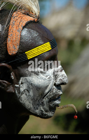 Karo chief with a white painted face, a clay headdress and colorful headband, profile portrait, Kolcho, South Omo - Stock Photo