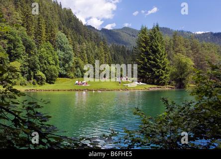 Fernsteinsee lake, bank, swimming guests, summer, Tirol, Austria, Europe - Stock Photo