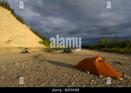Tent, camp on the shore of the Liard River, gravel bar, evening light, clouds, British Columbia, Yukon Territory, - Stock Photo