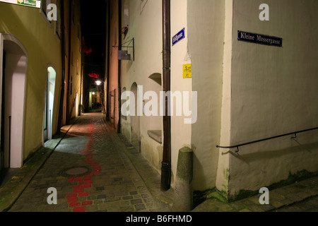 Narrow alley in the historic city centre of Passau at night, Bavaria, Germany, Europe - Stock Photo