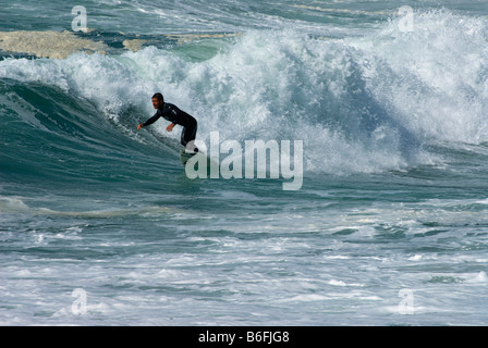 Surfer, surf at the Pointe de la Torche, Brittany, France, Europe - Stock Photo