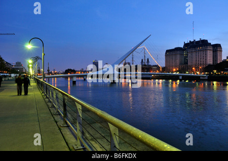 The old harbour Puerto Madero, restored for tourists, with the Puente de la Mujer, Woman's Bridge, evening, Buenos - Stock Photo