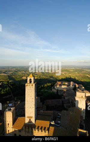 San Gimignano Tuscany Italy View across the Palazzo Vecchio del Podesta and the Torre Rognosa towards surrounding - Stock Photo