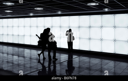 People taking photographs standing in front of an illuminated wall, Frankfurt, Hesse, Germany, Europe - Stock Photo