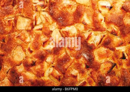 Apple pie with fresh apples, cinnamon, sticks of cinnamon and sugar - Stock Photo