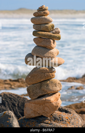 Little stone man on the Pointe de la Torche, Brittany, France, Europe - Stock Photo