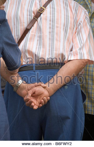 elderly couple seen from behind - Stock Photo