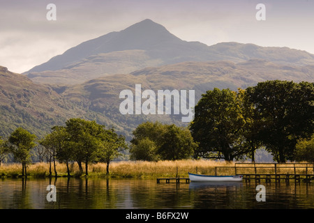 Boat on Loch Lomond Scotland with Ben Lomond in the background - Stock Photo