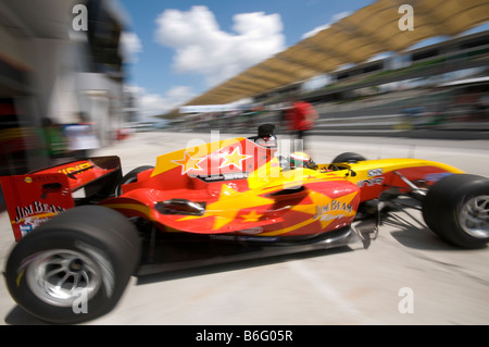 Motion blur of driver Ho Pin Tung of A1 Team China steers his car during practice session at A1GP World Cup of Motorsport - Stock Photo