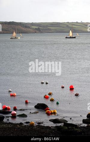 Oyster fishermen off Loe Beach Carrick Roads Feock Cornwall in Winter dredging. - Stock Photo