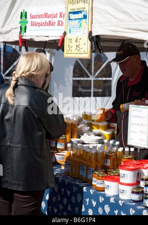 Selling homemade food at Kalaryssäys Kalaryssaeys market fair in Kuopio City Finland - Stock Photo