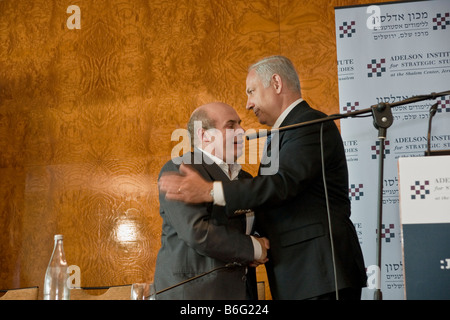 Former Israeli PM Binyamin Netanyahu hugs Nathan Sharansky, Chairman of the Adelson Institute for Strategic Studies. - Stock Photo