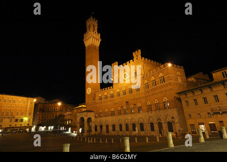 Torre del Mangia Tower Palazzo Communale and the Campo by Night Siena Tuscany Italy - Stock Photo