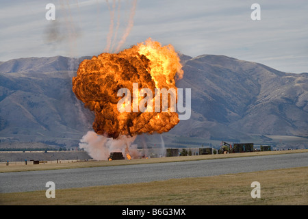 Controlled Explosions at Warbirds Over Wanaka Airshow Otago South Island New Zealand - Stock Photo