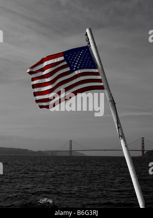 American flag in color on black & white background of Golden Gate Bridge San Francisco CA - Stock Photo