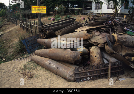 Scrap metal yard with US Vietnam War-era war scrap, cluster bomb casings and missiles, Phonsavan, Laos - Stock Photo