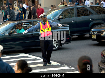 Traffic cop 42nd Street and Fifth Avenue New York City - Stock Photo