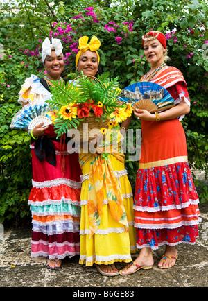 Cuban Ladies in Traditional Dress Plaza de Armas Old Havana havana Cuba - Stock Photo