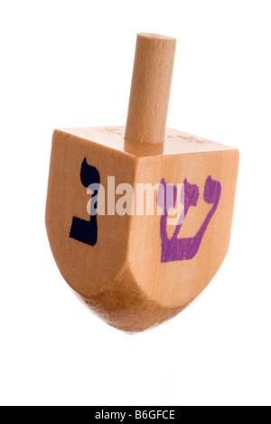 Hanukkah dreidel isolated on white - Stock Photo