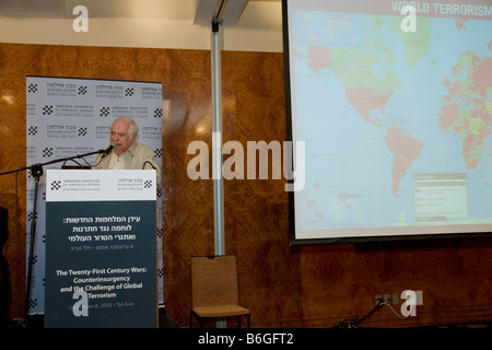 Prof. Bernard Lewis at the Adelson Institute's Dec. 2008 conference. A map of world Terrorism can be seen to the - Stock Photo