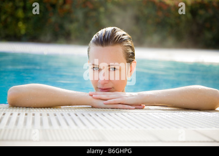 Portrait of young woman in spa front view - Stock Photo