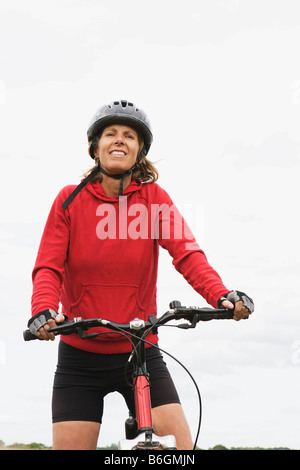 Woman cyclist on bicycle