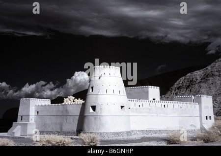 Infarred picture of Bukha Fort Musandam Oman using false colour and channel swapping - Stock Photo