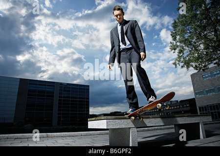 Skateboarder showing off his skills - Stock Photo