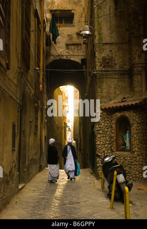 Two nuns on an alley in centro storico district of central Naples Italy Europe - Stock Photo