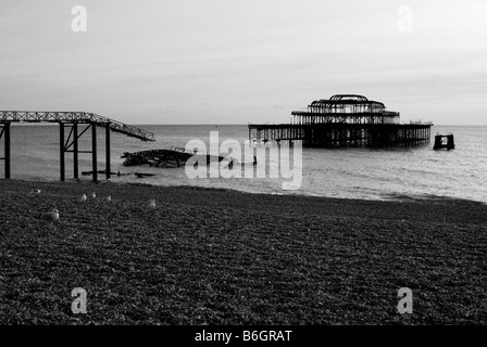 An Image of the burnt out remains of Brightons West pier - Stock Photo