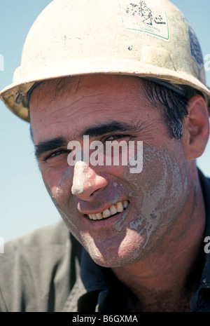 A roughneck or oil field worker on a wildcat oil drill ...