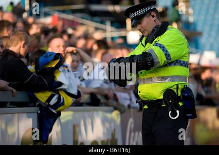 English Police man at English league football soccer match - Stock Photo