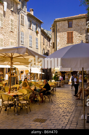 French cafe bar restaurants in the square in the old town of Vence, Cote D'Azur, Provence, France, South of France - Stock Photo