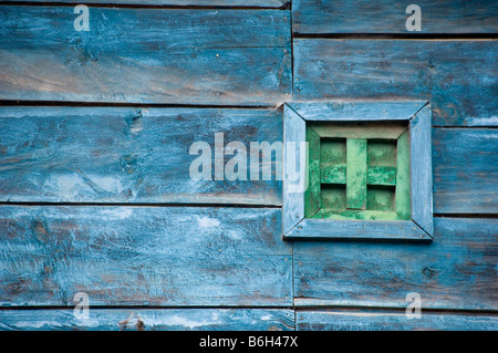 Detail of a worn out wooden house. - Stock Photo