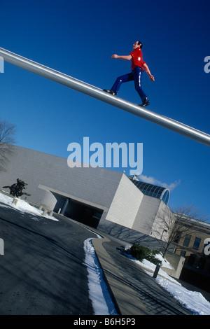 Boston. USA. West Wing of the Boston Museum of Fine Arts & Jonathan Borofsky's Walking Man sculpture. - Stock Photo