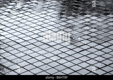 Wet paving after a rain storm creating an interesting patten. - Stock Photo