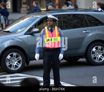 Traffic cop 42nd Street and Fifth Avwenue New York City - Stock Photo